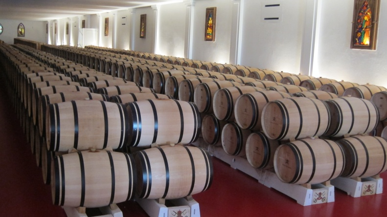 wine aging in oak casks. notice the stained glass windows.
