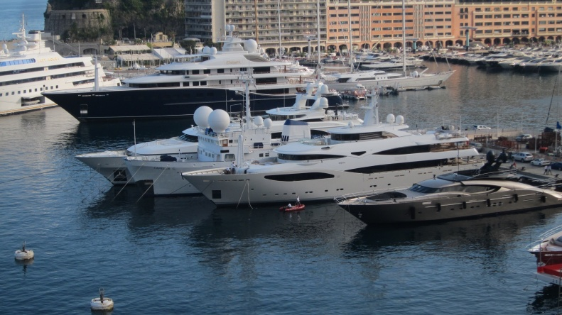 Monte Carlo harbor. to put the sze of these yachts in perspective, look at the guy washing one of the boats (good luck with that).